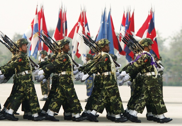 Soldiers carry their weapons as they march during the Armed Forces Day parade in Myanmar's capital Naypyidaw