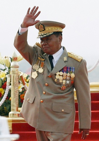 Myanmar's junta supremo Senior General Than Shwe waves his hand during the Armed Forces Day parade in Myanmar's capital Naypyidaw