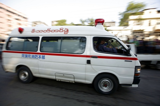 An ambulance rushes injured people to the hospital after series of explosions in Yangon