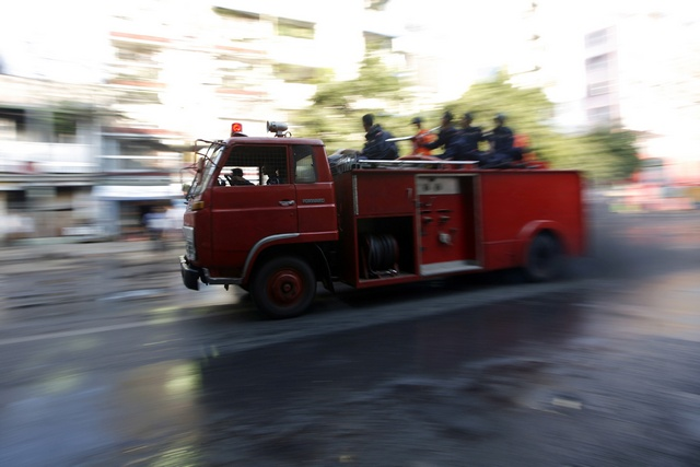 A fire engine rushes to the site of explosions in Yangon