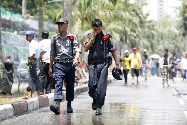 Police officers patrol in front of the X2O water pavilion, where three bombs exploded on Thursday, during Thingyan, Myanmar's new year water festival, in central Yangon