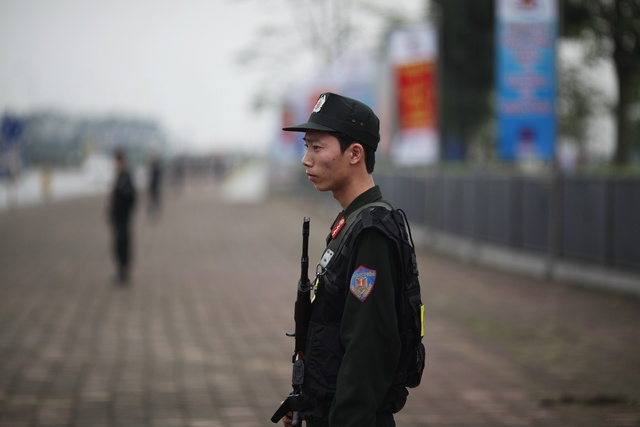 Vietnamese policemen secure the area around the venue for the 16th ASEAN Summit in Hanoi