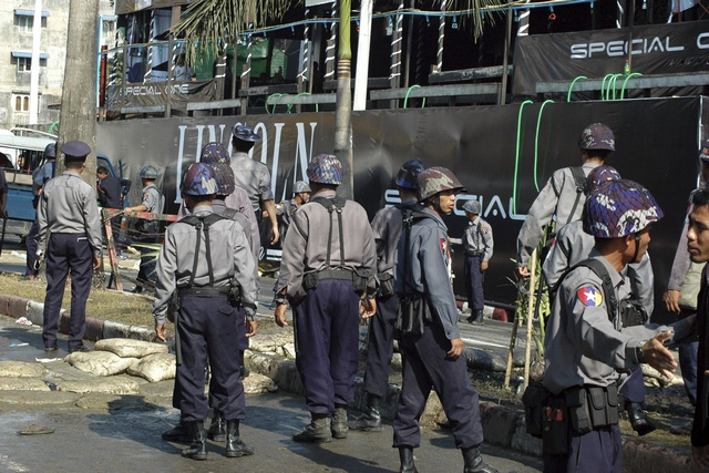Security forces gather at the site of the explosions in Yangon