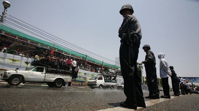 Police officers watch over during Thingyan, Myanmar's new year water festival, in central Yangon