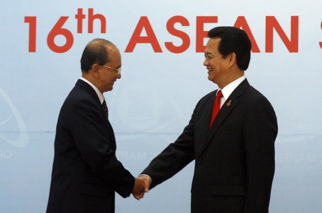 Myanmar's Prime Minister General Thein Sein is greeted by Vietnam's Prime Minister Nguyen Tan Dung before the 16th ASEAN Summit in Hanoi