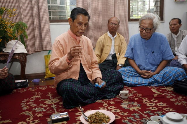 Vice-Chairman of the NLD Tin Oo talks to party members during a ceremony to mark the 20th anniversary of the 1990 election, in Yangon