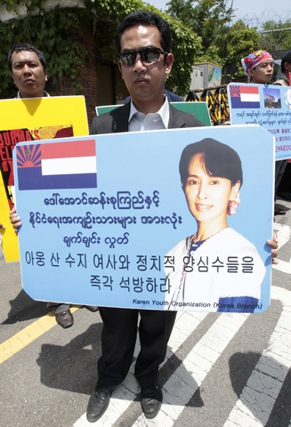 Activists from Myanmar hold a pro-democracy rally in front of the Myanmar embassy in Seoul