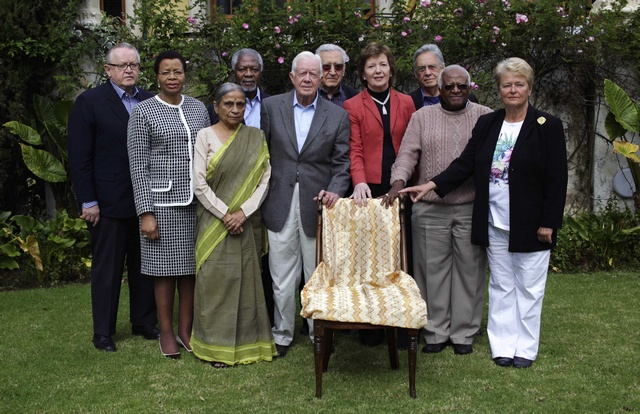The Elders, a group of global leaders founded by former South African President Nelson Mandela, pose for a picture during their meeting in Johannesburg