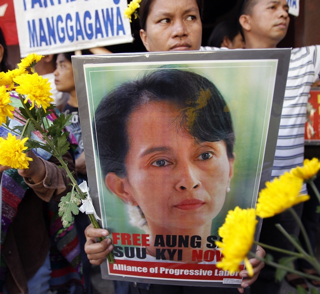 Filipino activists display a poster of Myanmar's pro-democracy leader Aung San Suu Kyi during a protest outside Myanmar's embassy in Makati