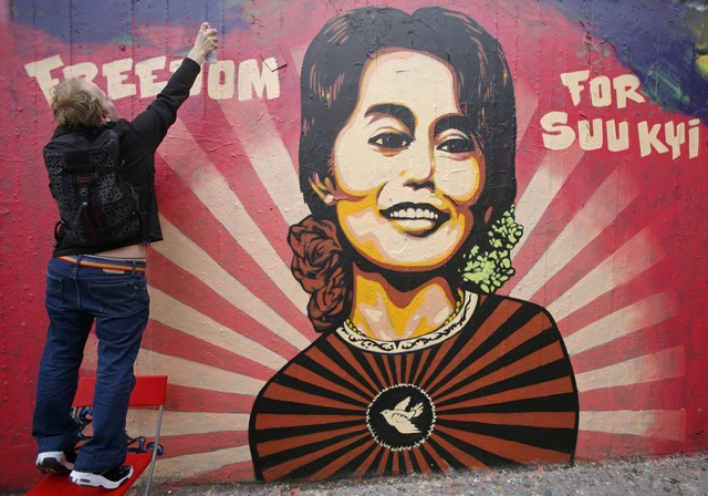 A graffiti artist finishes a mural of Myanmar's democracy leader Aung San Suu Kyi in Prague