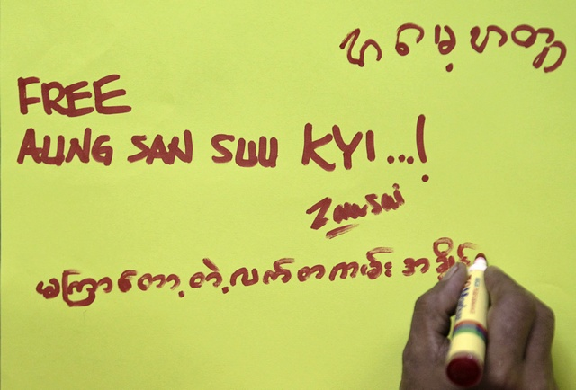 A Burmese refugee living in Malaysia writes a birthday greeting to Myanmar's detained pro-democracy leader Aung San Suu Kyi in Kuala Lumpur