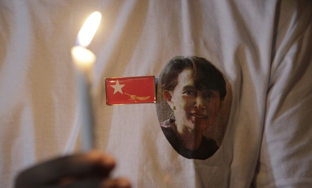 A Burmese refugee living in Malaysia wears a badge bearing the NLD's flag during a gathering to mark Aung San Suu Kyi's birthday in Kuala Lumpur