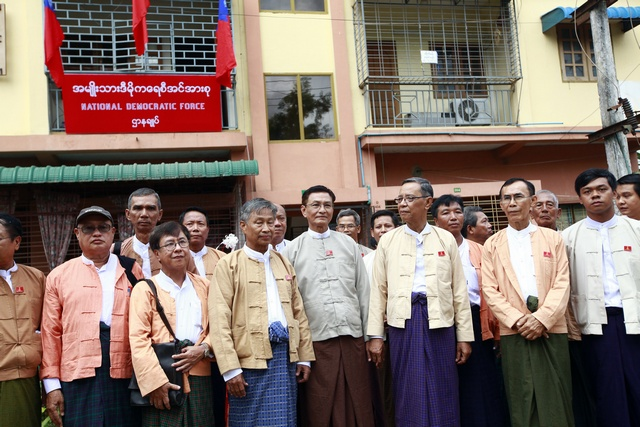 Members of the National Democratic Force party attend the opening ceremony of their party's new signboard and headquarters in Yangon