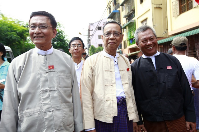 National Democratic Force party Chairman Than Nyein and one of the party's leaders Khim Maung Swe pose during the opening ceremony of their party's new signboard and headquarters in Yangon
