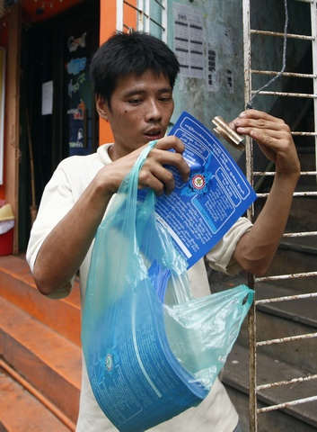 A member of the National Unity Party (NUP) prepares flyers during a campaign for Myanmar's upcoming elections