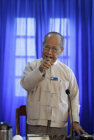 Khin Maung Gyi, general secretary of the National Unity Party, speaks to reporters in Yangon