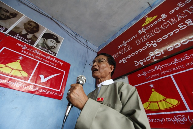 Khin Maung Swe, one of the leaders of the National Democratic Force party, speaks at the opening ceremony of their party's Bago division office