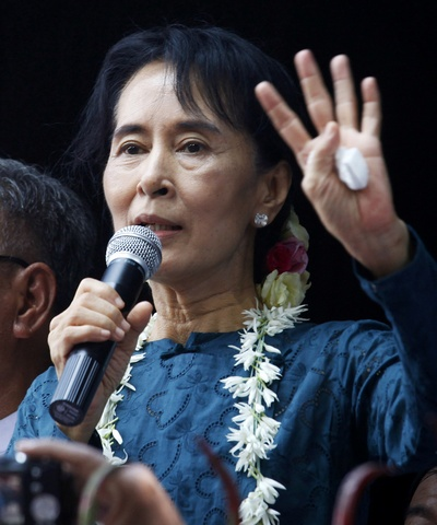 Aung San Suu Kyi addresses supporters outside her National League for Democracy party headquarters in Yangon
