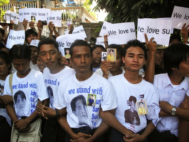 Supporters gather to hear Aung San Suu Kyi speak at the headquarters of her National League for Democracy party in Yangon