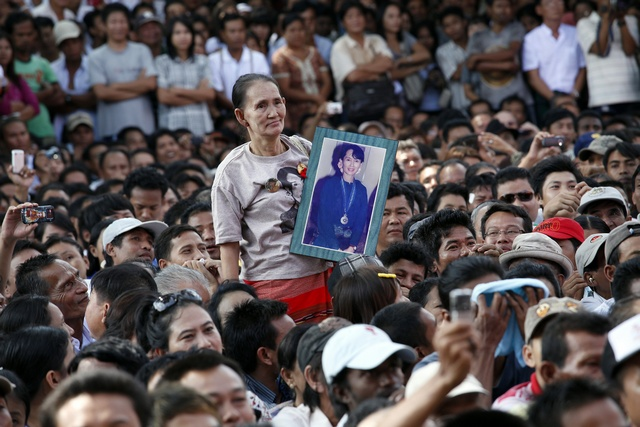 Supporters listen to Aung San Suu Kyi speak at the headquarters of her National League for Democracy party in Yangon