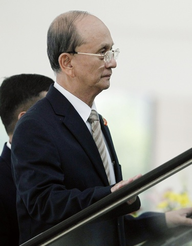 Myanmar's Prime Minister Thein Sein arrives for the ASEAN - China summit in Hanoi