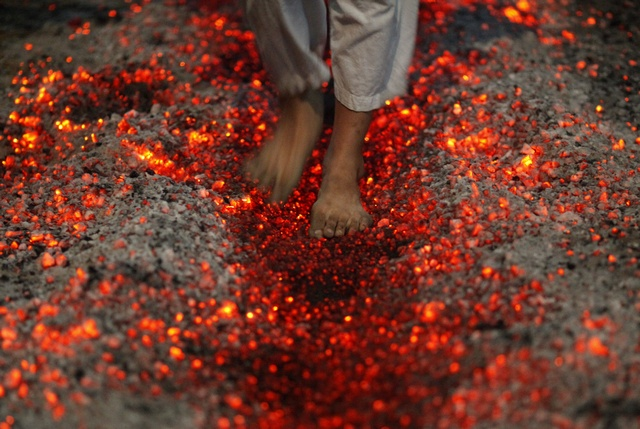 A Shi'ite Muslim walks on fire at a ceremony during the Ashura festival at a mosque in central Yangon