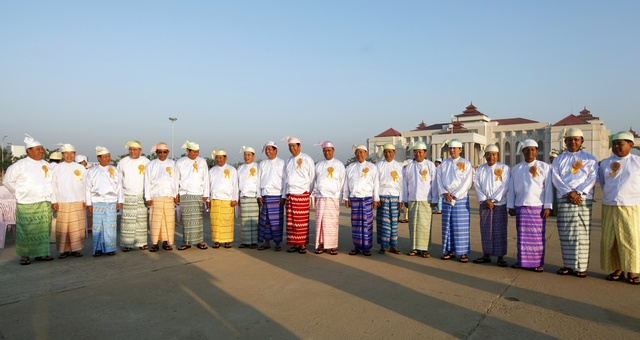 Members of parliament pose for a photo as they attend a ceremony to mark the 64th Myanmar Union Day in front of the City Hall in the new capital Naypyitaw