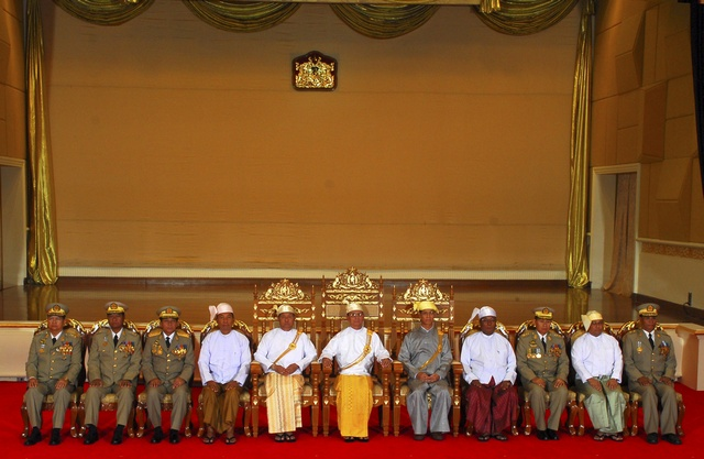 Myanmar's newly elected President Thein Sein, Vice Presidents and members of National Defence and Security Council pose for a group photo in parliament, in Naypyitaw