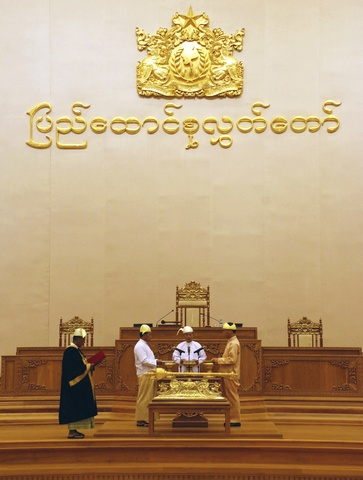 Handout photo of Myanmar's newly elected President Thein Sein and VPs Tin Aung Myint Oo and Dr Sai Mauk Kham taking the oath of office before the Speaker of Parliament in Parliament at Naypyitaw