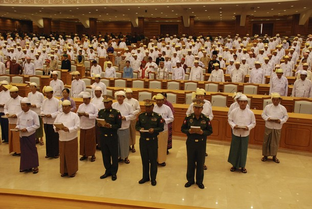 Handout photo of members of the Pyidaungsu Hlutaw (Union Parliament) taking an oath of office in the presence of the Speaker of Parliament at Parliament in Naypyitaw