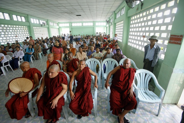 Buddhist monks wait for the funeral of a respected monk at Yaeway cemetery in Yangon