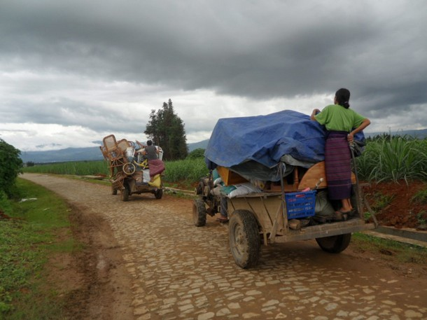 Ethnic Kachin refugees travel on vehicles with their belongings as they flee fighting near Myanmar's border with China