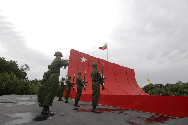 Guards of honour salute during an event marking the anniversary of Martyrs' Day at the Martyrs Mausoleum in Yangon