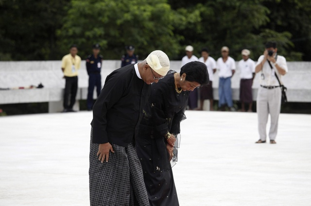 Aung San Oo and his wife bow during an event marking the anniversary of Martyrs' Day in Yangon