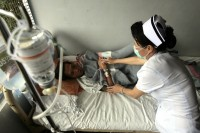 File photo of a nurse tending to a tuberculosis patient from Burma at the Mae Tao clinic in northern Thailand, May 2007. (PHOTO: Reuters)