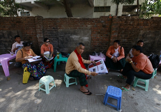 Delegates from Kachin state sit at a street after the end of National League for Democracy party's (NLD) congress in Yangon