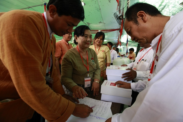 Delegates line up to get party congress books at the National League for Democracy party's (NLD) congress in Yangon