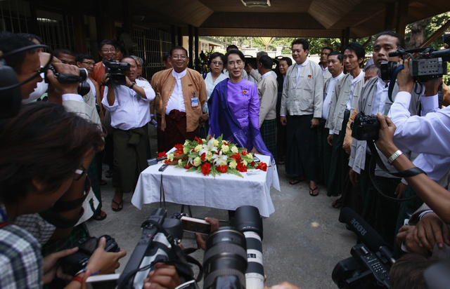Myanmar's pro-democracy leader Suu Kyi talks to reporters during news conference after National League for Democracy party's congress in Yangon