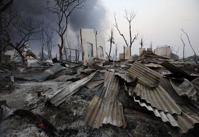 A burnt house is seen in Meikhtila
