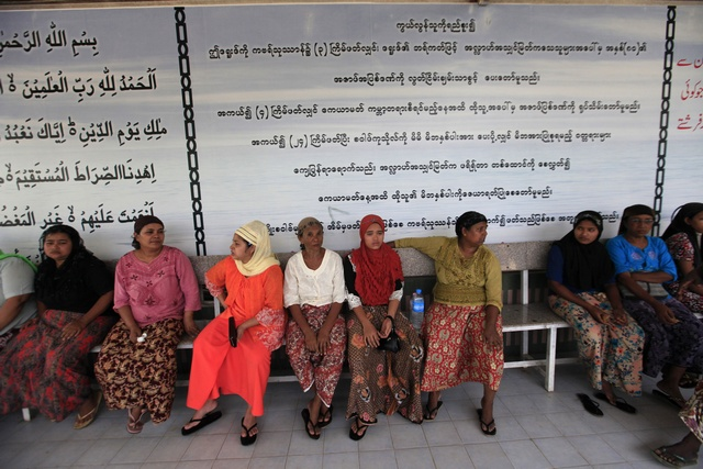 Relatives wait at Yaeway cemetery to attend the funeral of 13 boys who died in a fire at an Islamic school in Yangon