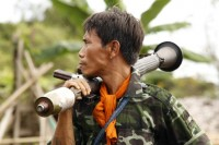In this file photo, a DKBA soldier carries a rocket launcher in the army's territory in Karen State, 2010. (PHOTO: F Wade/DVB)