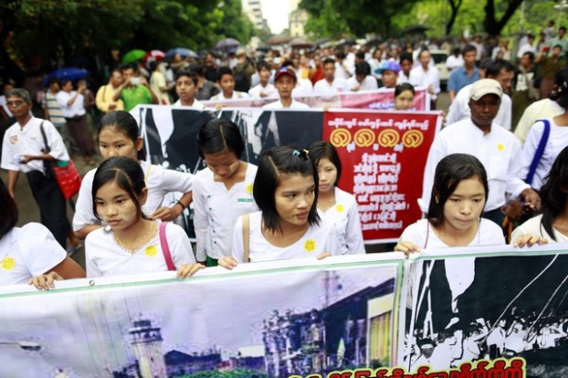 Students hold banners as they march to mark the anniversary of the 8888 democratic uprising in Yangon