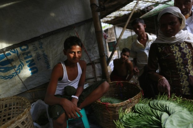 A Rohingya man sells betel leaves near internally displaced peoples (IDP) camps outside Sittwe