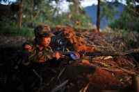 In this file photo a soldier is dug into a frontline hilltop in Kachin state, northern Burma (PHOTO: AFP)
