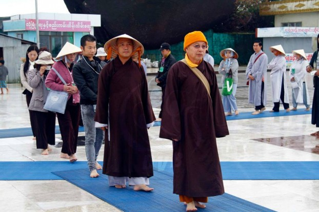 Buddhist pilgrims line up to pay respect at the holy site