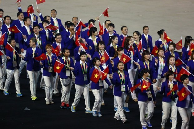 Vietnamese athletes take part in a parade during the opening ceremony of the 27th SEA Games in Naypyitaw