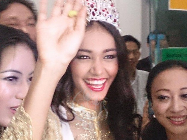 Burmese beauty stripped of crown, but absconds with tiara