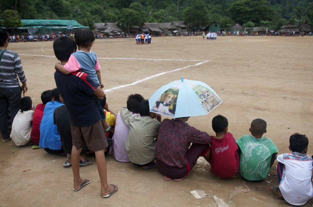 Spectators wait for the start of a football game at Mae La refugee camp. (PHOTO: Dene-Hern Chen)