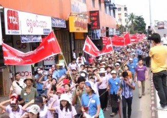 Dismissed employees of the South Korean-owned Master Sports factory rallied for severance pay in Rangoon, July 2014. (PHOTO: DVB)
