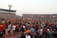 Hundreds of home fans invade the park in celebration at the end of the quarter-final match on 17 October, when Burma defeated United Arab Emirates 1-0.  (PHOTO: DVB)